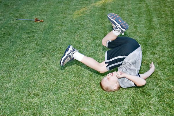 Aiden practices his forward roll, something he learned in taekwondo.