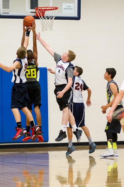 Grandson A reaches for the rebound. Taken at Legend High School, Parker, Colorado, USA.