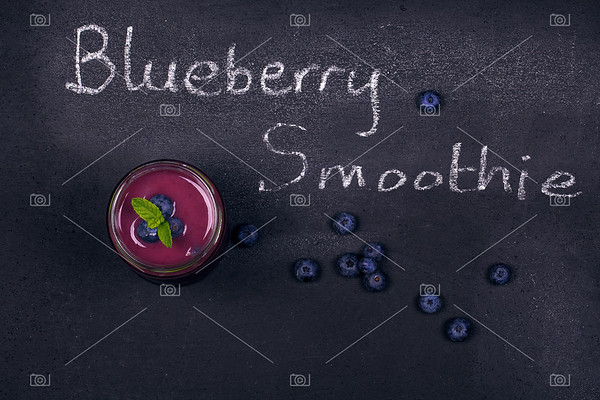 Blueberry smoothie on chalk board