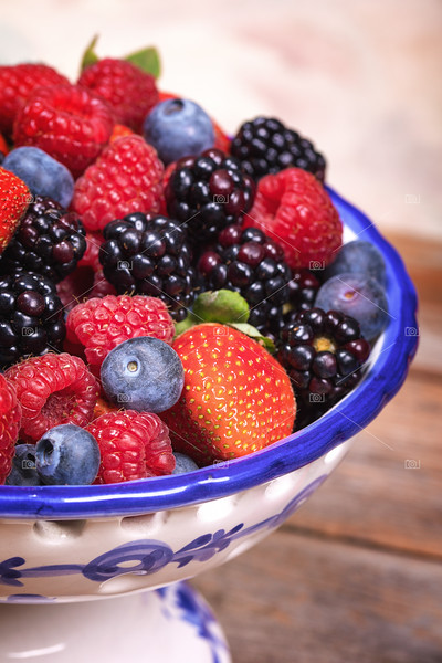 Summer fruits in a blue and white ceramic bowl