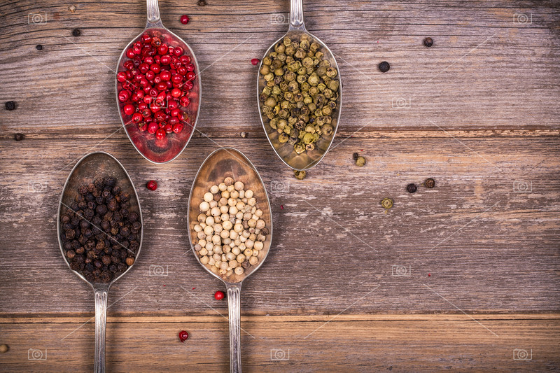 Peppercorns in silver spoons