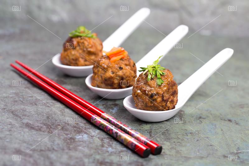 Asian meatballs and chopsticks