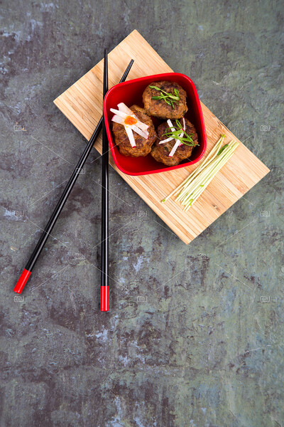 Asain meatballs over slate background