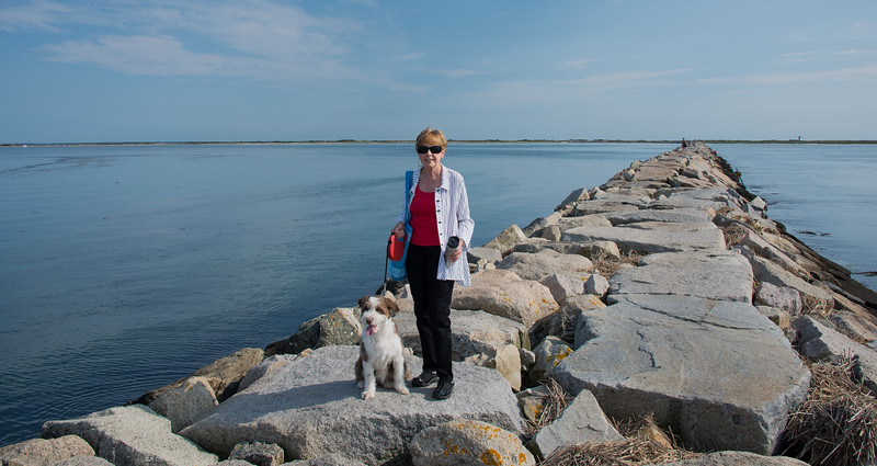 Faithie and Carly on the stone jetty at the west end of P-town, a mile+ breakwater leading out to Long Point