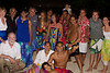 "After the performance.  Everybody from Te Miti is included except, once again, Nathalie.  Whoever took this photo (with my camera) managed to cut off both the left and the right and Nathalie who is just off camera down in front.  That's Faithie and me on the far left next to Deepal and Priyani.  Wayne is to Priyani's left (""right"" in the photo), Lily in the orange/green/blue dress dead center, and Sylvain and Susan at the far right."