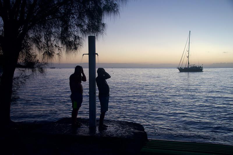 Wayne and Deepal de-salinizing after a final swim the last night back on Raiatea