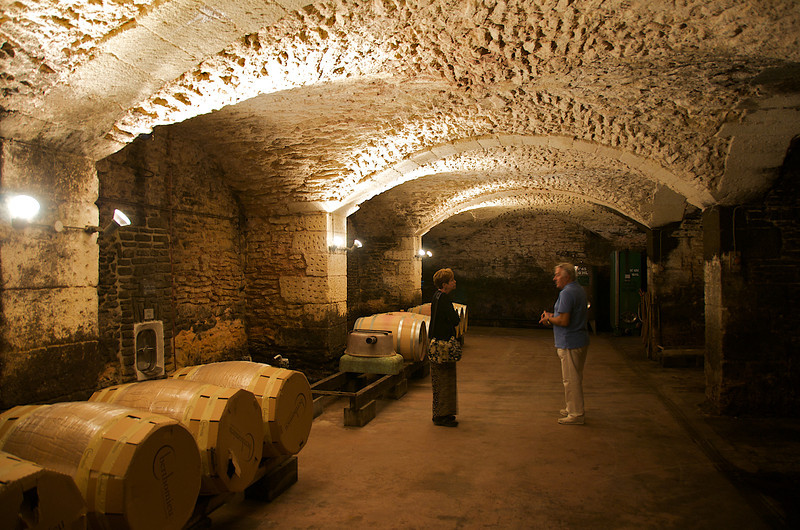 Faithie and Charles in the cellars at Chåteau St. Estève d'Uchaux