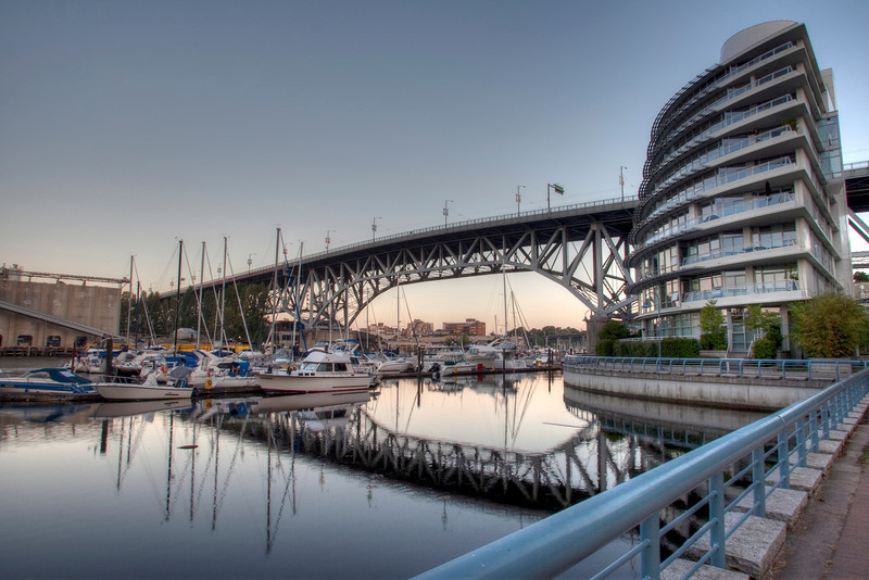 A view of the Granville Bridge from the North boardwalk across from Granville Island in Vancouver BC.