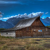 Mormon Row may be one the most picturesque areas of Grand Teton National Park, with rustic, wooden buildings surrounded by open fields, grass and sage standing out against the stunning backdrop of the Tetons. For watching wildlife; taking a quick, easy walk; for seeing into the lives of the West's early settlers, a trip to Grand Teton National Park really isn't complete without a visit to Mormon Row. This image was processed in HDR using Photomatix Pro 4.<br /> <br /> Mormon Row is located in Grand Teton National Park off of Antelope Flats Rd, about one mile east from Hwy 26/89/191. The Antelope Flats turnoff is just north of Moose Junction.