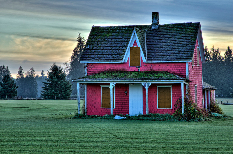 This long since abandonded farm house now sits in the middle of a sod field. hence the nicely manicured grass, in Langley, BC. The farmer had to regrettably board up the windows to prevent further vandalism.  Processed in HDR soft's Photomatix, and filtered in Topaz software.
