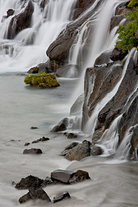"""Multi-Falls""  Hraunfossar, a series of waterfalls that stream right out of the bedrock of lava rock. Taken in Borgarfjörður, West Iceland, Iceland."