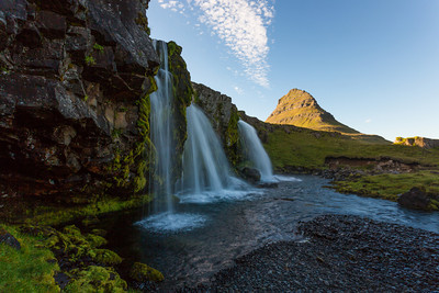 The waterfall named Kirkjufellfoss, with the mountain Kirkjufell in the background. Taken near Grundarfjörđur, West Iceland.