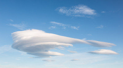 Lenticular clouds, due to high winds aloft. Taken on the Snæfellsnes Peninsula, West Iceland.