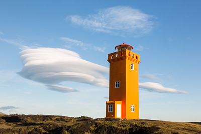 Svörtuloft lighthouse, with lenticular clouds. Taken on the Snæfellsnes Peninsula, West Iceland.