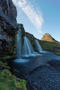 """Triple Waterfall in Iceland""  The waterfall named Kirkjufellfoss was one of the top things that I wanted to see in Iceland. We actually returned there twice and got to camp in the rental RV right below there. Here you see it with triple falls and with the mountain Kirkjufell in the background. Taken near Grundarfjörđur, West Iceland."