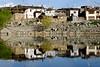 Nako village reflects in the lake where Guru Padmasambhava meditated