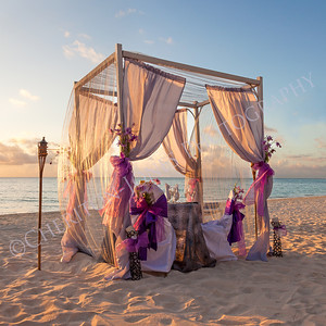 Romantic Wedding Table on Sandy Tropical Beach at Sunset