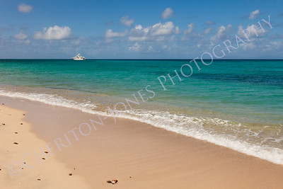 Tropical Beach Seascape with Motor Yacht
