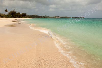 Tropical Sandy Caribbean Beach with Cloudy Overcast Sky