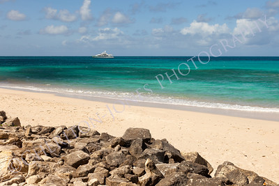 Tropical Caribbean Beach Seascape with Motor Yacht