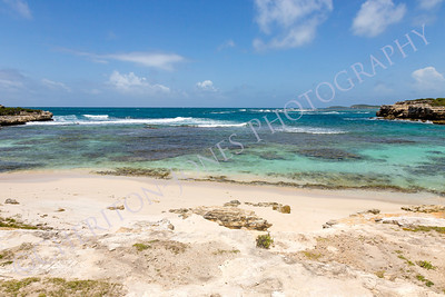 Beautiful Rustic Caribbean Sandy Bay and Sea