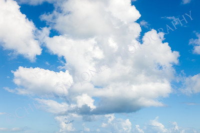 Cloudscape with Blue Sky and White Fluffy Cumulus Clouds