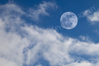 Full Moon on Blue Sky with Cumulus Clouds