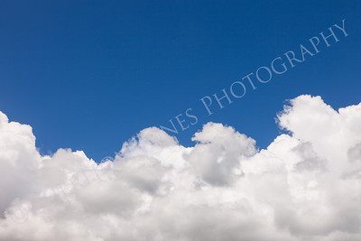 Blue Sky with Fluffy Clouds and Copy Space