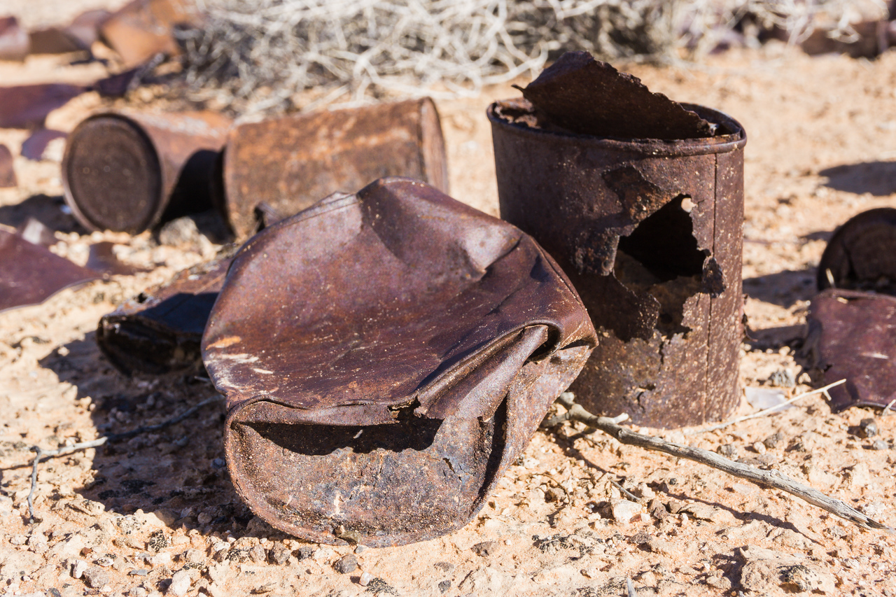 Rusted cans, used as shooting targets, in the desert. Taken near Overton, Nevada, USA.