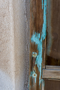 Peeling turquoise-colored paint on a door frame. Taken in Mesilla, New Mexico, USA.