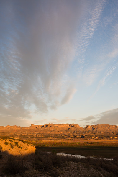 Clouds at sunset above the Fra Cristobal Mountains. The Rio Grande River lies below, in what would normally be Elephant Butte Lake. Taken from Elephant Butte Lake State Park, New Mexico, USA.