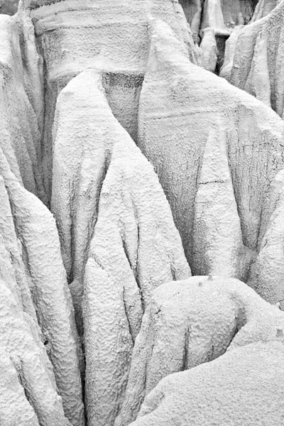 """Shrouded In Stone""<br /> <br /> These eroded forms in the soil reminded me of human forms shrouded in traditional dress. Taken in Theodore Roosevelt National Park, North Unit, North Dakota, USA."