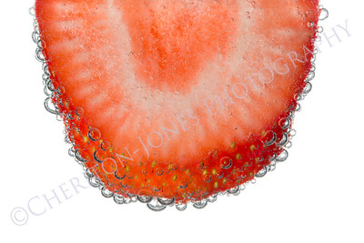 Strawberry Slice in Clear Fizzy Water Bubble Background