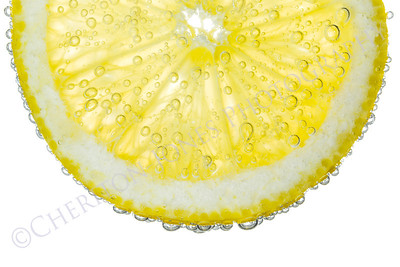 Lemon Slice in Clear Fizzy Water Bubble Background