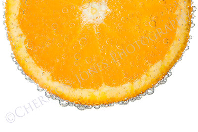 Orange Slice in Clear Fizzy Water Bubble Background