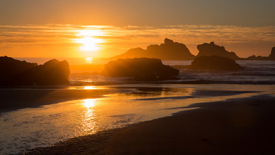 """Bandon-On-The-Sea""  We seemed to hit the rainy season one fall in the Pacific Northwest. But every once in a while, the sun would break through and make a spectacular scene at sunset. Taken at Bandon Beach, Oregon, USA."