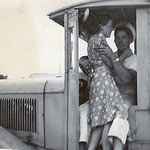 Mom & Dad hugging in milk truck
