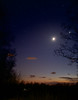 Looking west toward the Catskills in late April.  Orion standing tall on the left; the moon and Venus on the right.