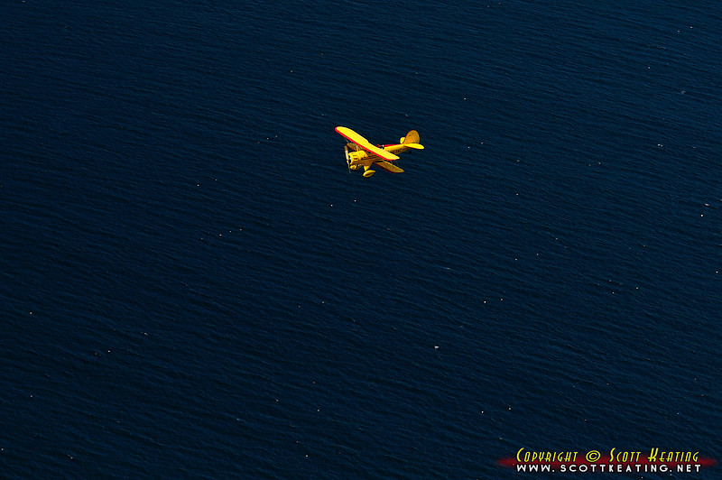 Yellow sight-seeing tour Waco biplane near Bar Harbor, Maine