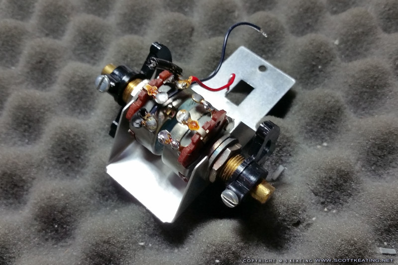 The modified aux-channel assembly