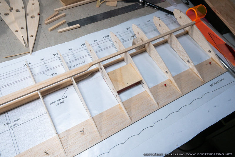 Assembling the wing, gluing the ribs to the trailing edge and lower spar. The upper-spar is used to help keep the ribs vertical while gluing.