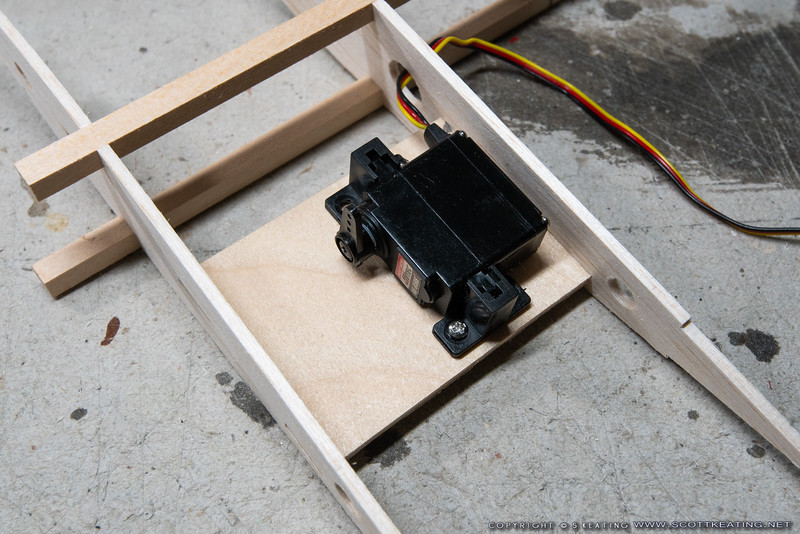 Test fitting the servo on the mount plate before installing