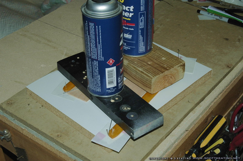 Gluing the strut-wires in a jig