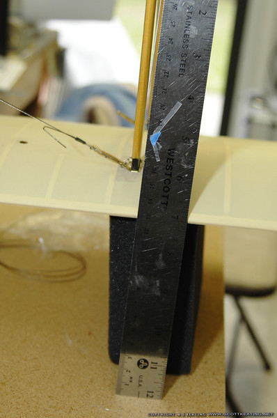 Setting dihedral:  Then measure the height of the leading edge at the strut.  The aimpoint for the dihedral can be measured off the plans
