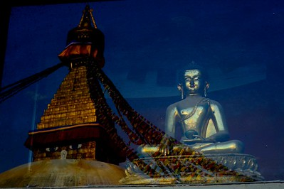 Buddha statue with Boudhnath Stupa