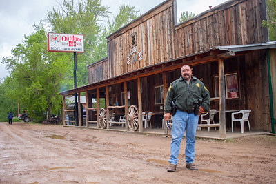 """This (Jarbidge) is the last of the hold-outs right here. You're not going to find many more places like this anywhere.  ""When I first started back in the `90s we used to have to bring inmates up here. Judge Johnny would put his robe on while there were people in the bar. Then he'd grab his gavel and beat it on the bar and yell 'bar's closed, court's in session.' Then they'd go through the whole court process. Then after court he'd beat the crap out of the bar and say, 'court's done, bar's open.' That was the Red Dog Saloon.  ""When I started here, the doors used to swing open, and they used to have a band back in the corner. Some idiot rode his horse into the bar. The door came crashing open, and this guy rode in. He had his hat in his hand and was like, 'wahoo!' His horse shit all over the place and knocked over the drums. He went out the back door, and he hit his head on the door, got bucked off. I was like, 'you want me to take him to jail?' They were like, 'na, just tell him to clean up the horse shit.' Then they got back to playing the music.""  -Aitor Narvaiza, Elko, Nevada (Photographed in Jarbidge, Nevada)  Narvaiza, who was born in the Basque Country of northern Spain, works as sergeant for the Elko County Sheriff's Office, and as of spring 2018 had worked in and around Jarbidge for 24 years. In nearly a quarter decade of working in Jarbidge, he said he's never had to investigate a serious crime there. Most calls involved accidents and alcohol, he said, and he can often be found on a Saturday evening driving people back to their houses or campsites from the town's two watering holes to keep them off the road. He is running in 2018 for Elko County Sheriff."