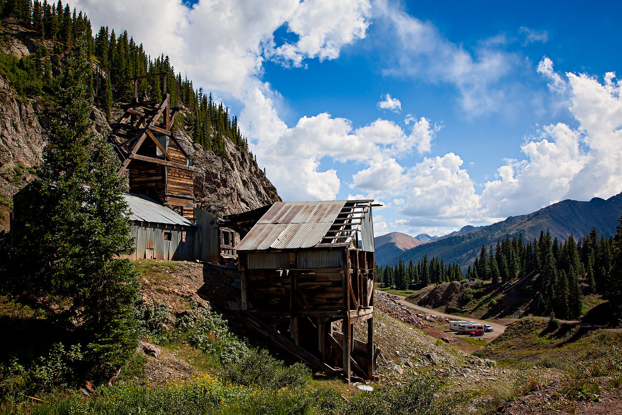 """""""San Juan Getaway""""<br /> <br /> The historic Longfellow Mine, in the Red Mountain Mining District of Colorado, USA. You can see our RVs down below. It was a fantastic campsite, cool in summer, and close to the wildflower areas and waterfalls."""