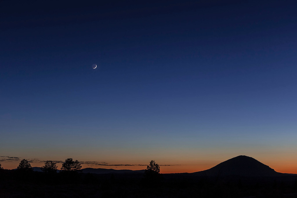 New moon setting, Lava Beds National Monument, CA