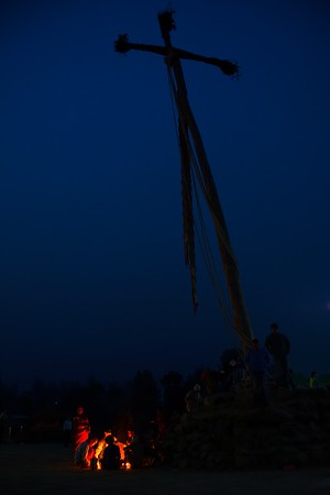 devotees doing puja at the feet of the new year pole in Yoshin Khel