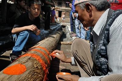 Laha maru Yoshin thanegu: pole erection in Talako tole. A man painting symbols on the the pole